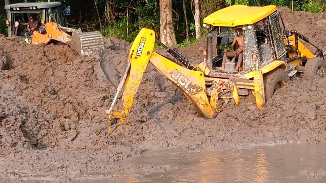 Deep Sticky Mud-JCB and Case Backhoes-Working together