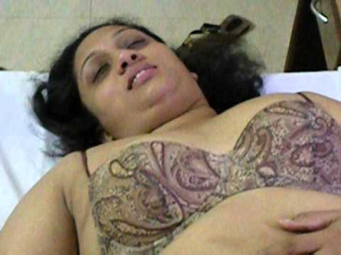 Indian wife showing her assets to hubby thumbnail