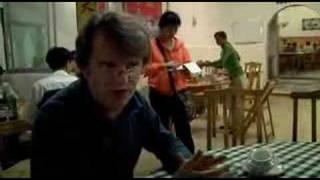 Paul Merton China eating dog