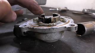 Как устранить стук в двигателе ( ГБЦ ) от осевого смещения распредвала.