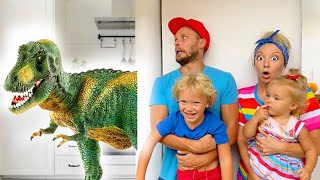 Lev and family play with dinosaurs in the house