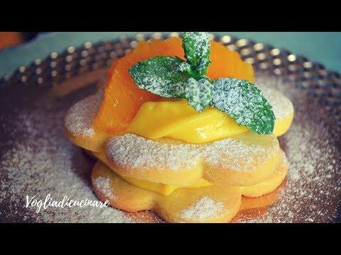 Tartellette di pasta frolla con crema all'arancia