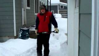 Cory Shoveling Snow