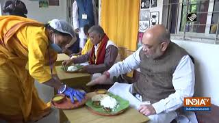 Home Minister Amit Shah eats lunch at Baul singer's residence