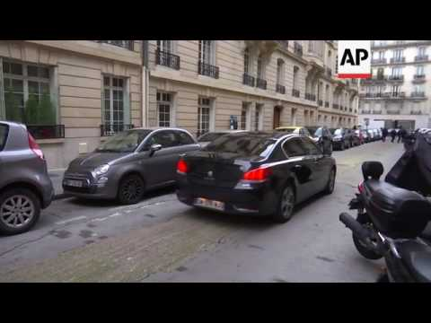 Embattled French candidate Fillon departs home