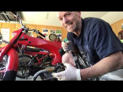 How to remove and clean Honda C110 carb