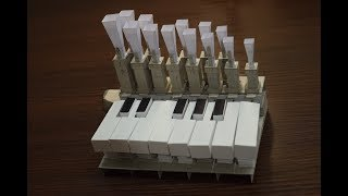 Organ with reed pipes from paper