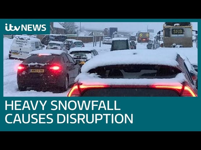 Travel disruption continues as heavy snowfall heads east | ITV News