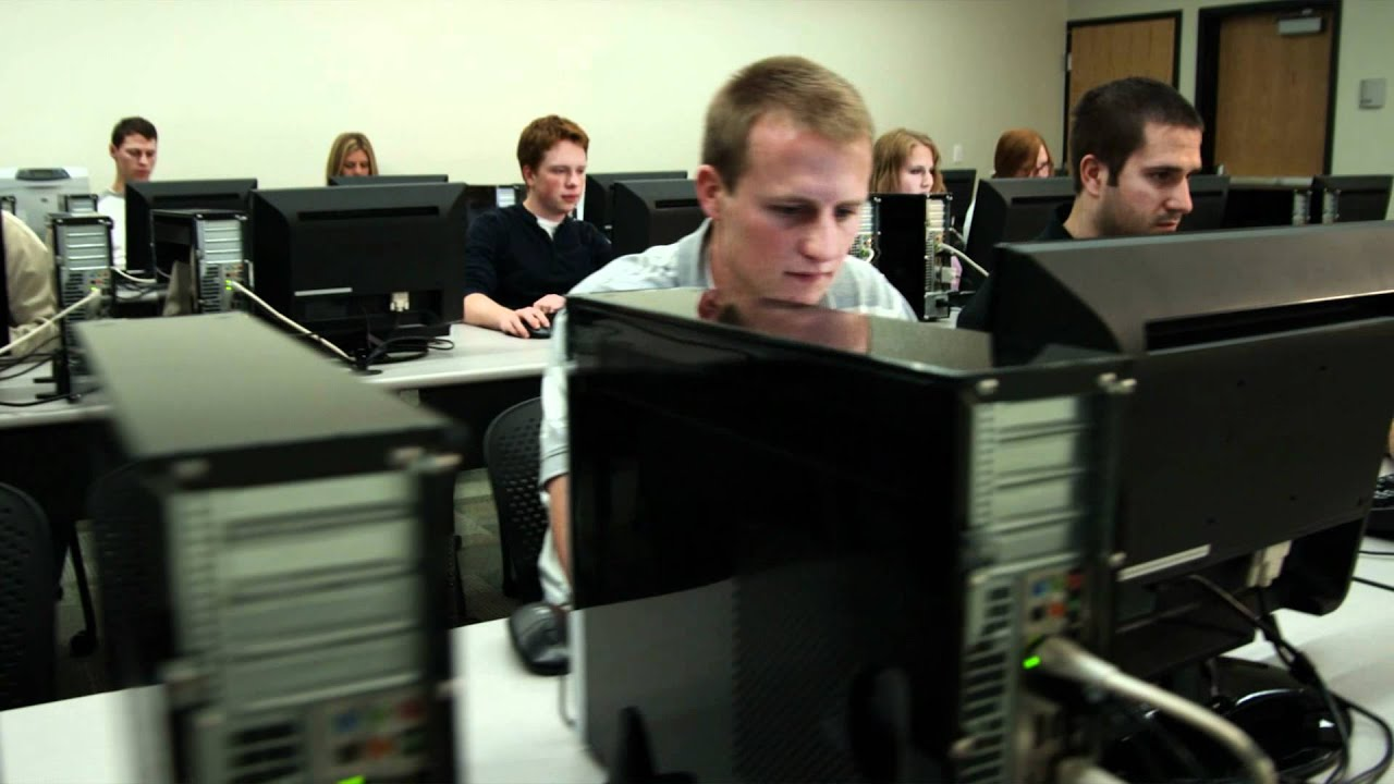 Students working on computers in lab HD stock footage ...