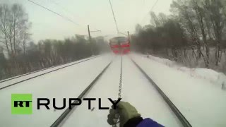 Russia: Watch young Russian daredevil ski behind speeding train