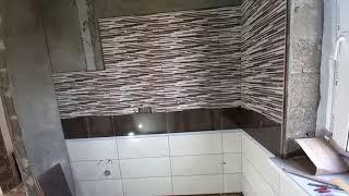 ст.Гостагаевская. Наша стройка. Укладывают керамогранит в ванной комнате и на первом этаже.