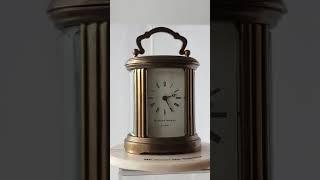 Miniature oval Matthew Norman brass clock
