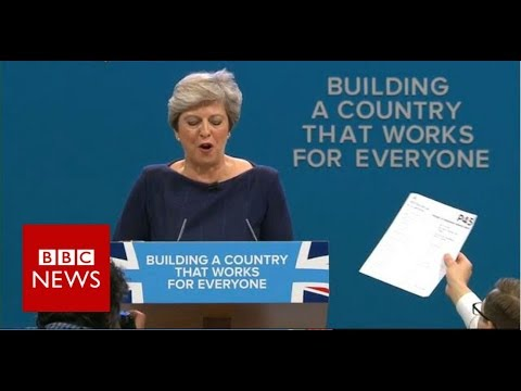 Protester interrupts Theresa May's keynote speech - BBC News