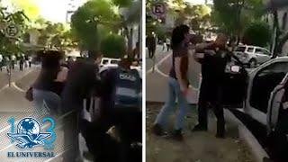 Mujer agrede a policía e intenta manejar patrulla en la Roma