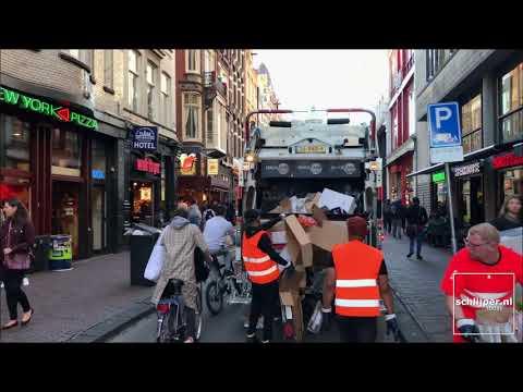 Garbage truck at Damstraat Amsterdam