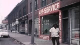 U.S. Police search car and damaged store during Detroit riots in Michigan, United...HD Stock Footage