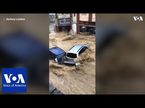Cars swept away as flash floods rage through Ellicott City, Maryland