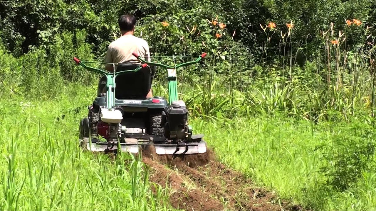 2 Tiller Shark tow behind by a gardenlawn tractor for tilling