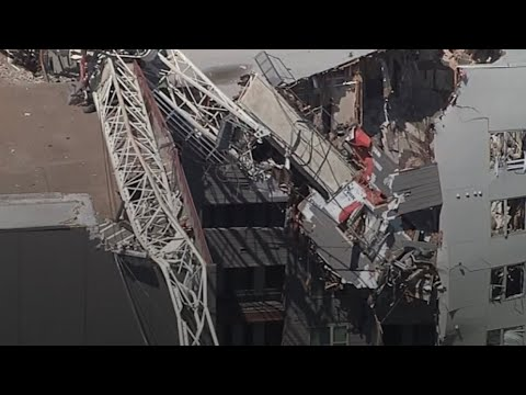 At least one dead after crane crushes apartment building, parking garage in Dallas amid severe weather