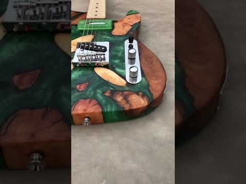 Amazing epoxy guitar made from Driftwood and resin