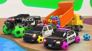 The boy plays in the kindergarten with toy cars. soccer balls! Police car pursuit of a sports car