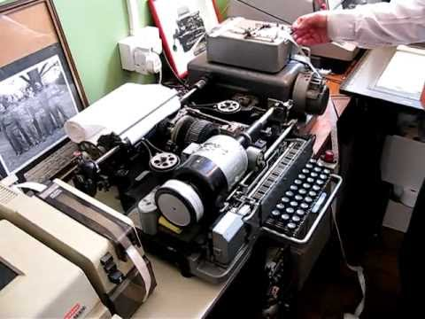 Teletype & punch tape reader writer. Amazing sound of mechanical machines.