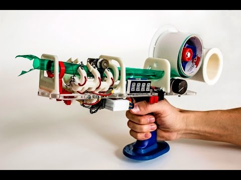 This Crazy Handheld Gun Extrudes Packing Tape Into Rigid Cylinders