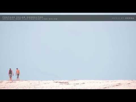FreeStockFootage.Club: People Walking In Distance On Beach