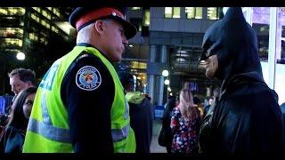 Police officer threatens to arrest Batman in Toronto