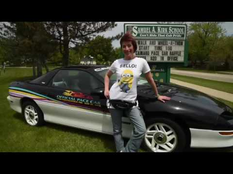 Kirk School nurse Wendy Meyer auctions off her car for athletic track