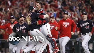 Nationals sweep, a new spacesuit, Catalonia protests: World in Photos, Oct. 16