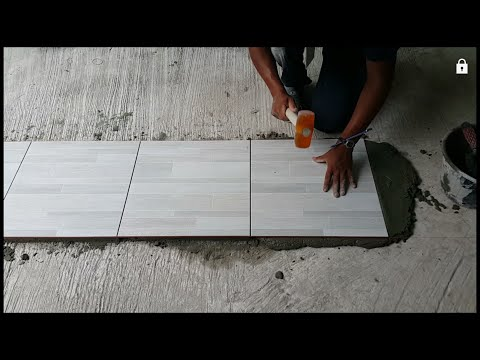 How to tile floors/find way to tiled by using water level/if you watch you can do it.
