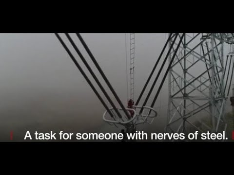 Nerves of steel: High up on China's power lines