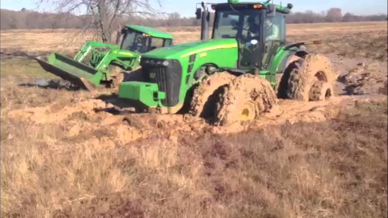 tractors stuck in the mud doovi. Black Bedroom Furniture Sets. Home Design Ideas