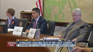 Lawmakers debate fate of red-light cameras