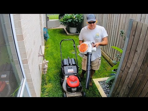 lawn-mowing-a-tiny-house-backyard-honda-lawn-mower-stihl-trimmer-blower