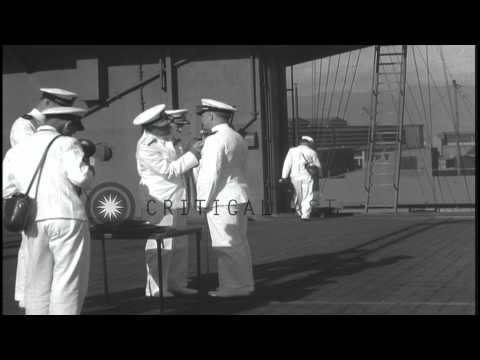 Sailors and officers being awarded aboard a ship at Pearl Harbor in Hawaii. HD Stock Footage