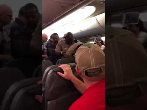 Psycho Tased and Removed by Miami Dade Police on American Airlines Flight
