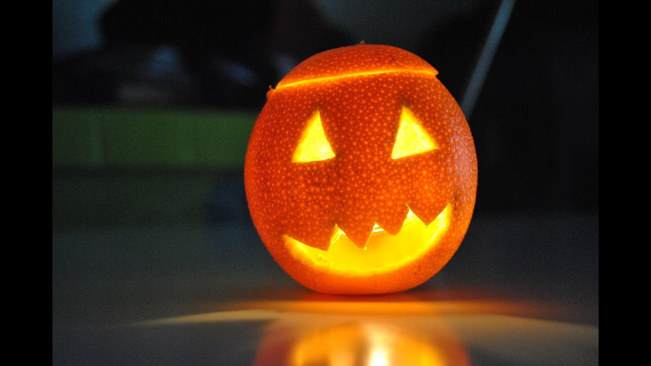 Como hacer una naranja de halloween (How to do a halloween orange)