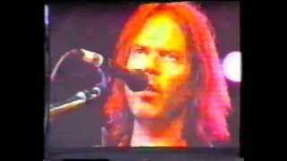 neil young performing sittin on the dock of the bay at slane castle 10 july 1993