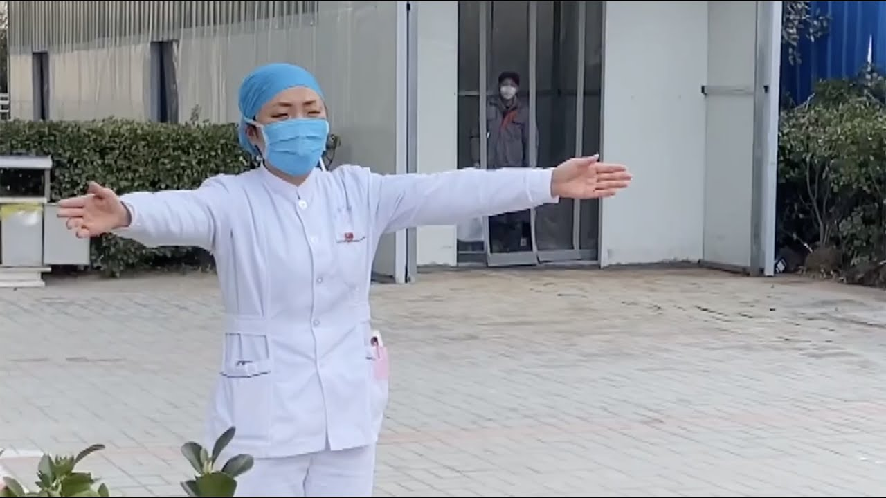 Chinese nurse fighting against coronavirus gives daughter an air hug