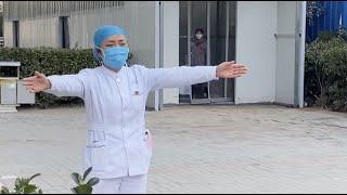 Chinese Nurse Fighting Against Coronavirus Gives Daughter An Air Hug