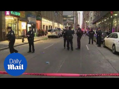 Three men wounded in brazen midtown Manhattan shooting - Daily Mail