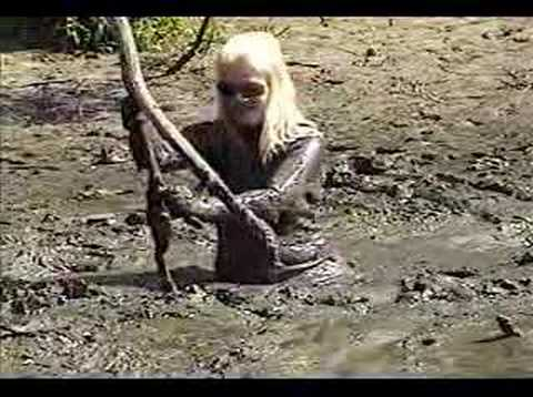 Chris stuck in mud quicksand in rubber wetsuit