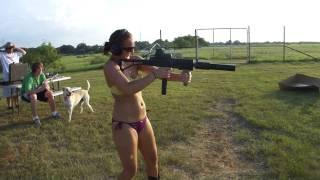 Girl in a Bikini Shooting Suppressed Sub Machine Gun M11/9