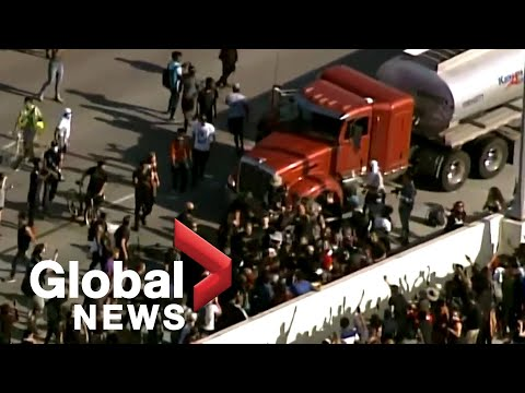 George Floyd protests: Tanker truck drives towards thousands of protesters on bridge in Minneapolis