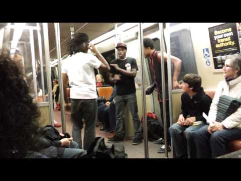 A dance group performs breakdance moves on the Metro in DC