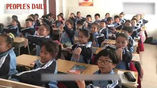 Horse racing dance adapted into classroom workout in an elementary school in Inner Mongolia