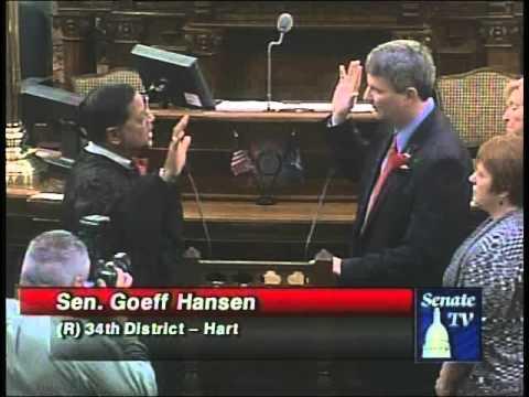 Sen. Goeff Hansen is sworn in during a ceremony at...