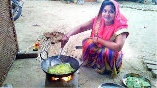 Homemade Tamota Fritter woman making tamato bajji
